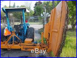 Ford 515 tractor with woods rear ditch mower, diesel, all hdy drive and angle